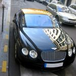 thumbnail image of Bentley and Aston Martin with the Golden roof